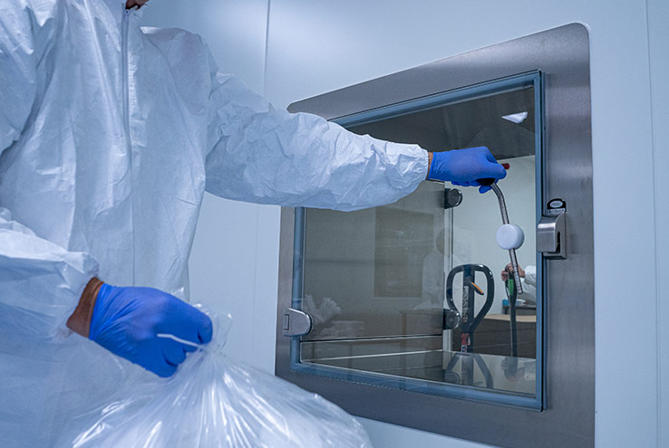 AQF Medical employee in a controlled cleanroom